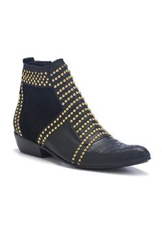 Gold studded boots.