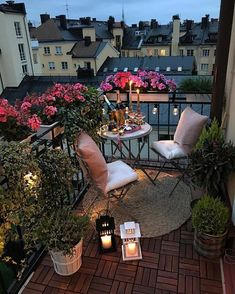 cozy European city patio with flowers and plants