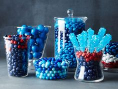 Tennessee Titans : Nearly any dark-blue or red candy will work in this display, but be sure to find a good representative of the lighter shade of Titan blue! We matched it perfectly with Sixlets, M&M's and rock-candy pops, then displayed them in various glass containers.