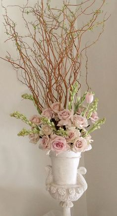 Floral arrangement with soft pinks and branches
