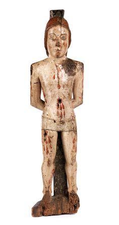 Höhe: 58 cm. Wohl Süditalien/ Sizilien, 12. Jahrhundert. Standfigur jugendlich wiedergegeben mit nacktem Körper, der Unterleib mit kurzer Hose bekleidet. Die...