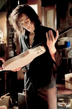 Tom Hiddleston...with a rock star look...and a guitar...in Only Lovers Left Alive...*dies*