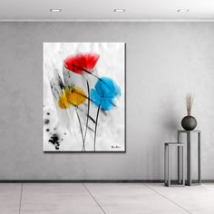 The 'Painted Petals III-B' canvas art depicts the boldness of flower petals as vivid yellow, red, and blue blossoms flare through a gray ground. This canvas features a modern floral and still life style and is gallery-wrapped for a look that will be cohesive with your home decor. - Brand: Ready2HangArt - Title: Painted Petals III-B - Product type: Gallery Wrapped Canvas - Style: Contemporary - Format: Horizontal - Size: Over-size - Subject: Floral - Medium: Ink Print - Image dimensions…