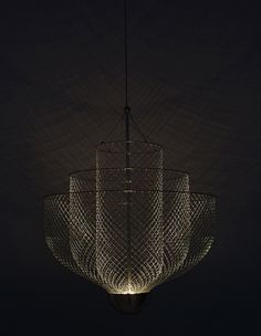 'Meshmatics Chandelier' by Atelier Rick Tegelaar. In this chandelier, the mesh works as a reflector to spread light throughout the room and creates an elaborate web of shadows. Interior Lighting, Modern Lighting, Lighting Design, World Of Interiors, Shop Interior Design, Chandelier Lighting, Chandeliers, Light And Shadow, Lamp Design