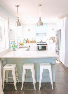 Gorgeous-Coastal-style-white-shaker-kitchen-with-aqua-blue-at-thehappyhousie.com-39