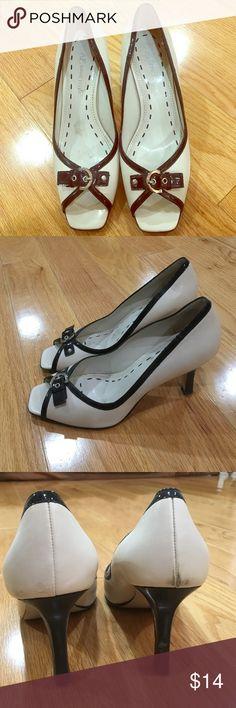 Classy Anne Klein cream & black peep-toe pump Anne Klein cream peep-toe pump with black trim and silver buckle, size 7.5. Gently worn. Smoke/pet free environment, very classy! Anne Klein Shoes Heels