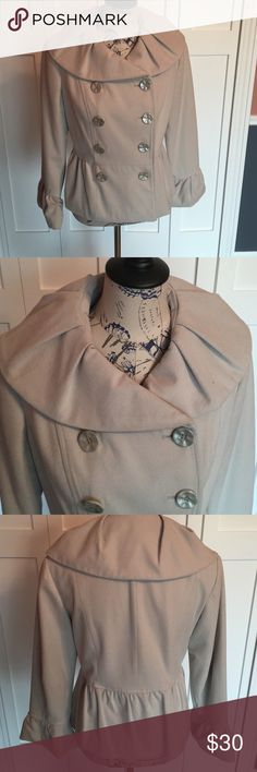 Insight jacket Cute beige coat, double breasted and 3/4 sleeves.  I'm tall and the sleeves came down to above my wrist.  I wore long black gloves with coat.   The coat hits at my waist, I have only worn a couple of times.  Bought at boutique shop. Insight Jackets & Coats