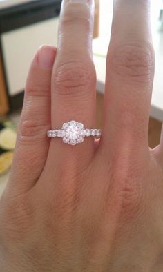 Small center stone with a chunky, eight-stone halo. Love!