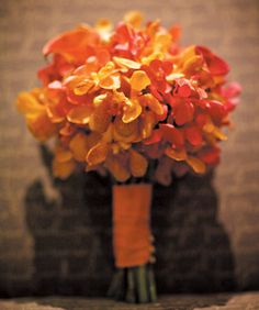Brides: Exotic Orange Orchid Wedding Bouquet. The bride's hand-tied bouquet, that was created by florist Amy Smith of Flirt, was composed of different colored orchids.