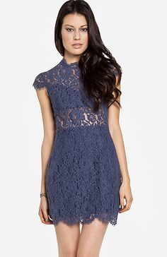 cute dress would go great with curled or flat ironed hair and some knee-high black boots