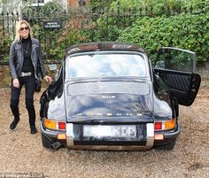 Great Kate! All dressed in black, Kate gets set to hit the road in her new black sportcar