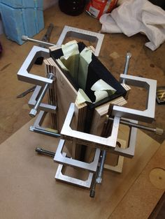 Twelve mini-clamps required to hold the glued long grain mitres on this Bog Oak pen box.
