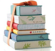 Dollar store books.. stacked and stamped! Cute decor or gift!