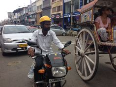 Road safely: wearing a construction helmet on a motor bike....
