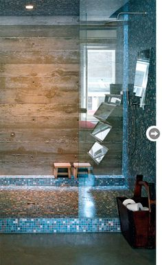 wooden bathroom wall-gives such a rustic look; mixed with the glass, it's beautiful!
