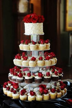 45 Totally Unique Wedding Cupcake Ideas Wanting some uniqueness to your wedding treats? We have a list of the unique wedding cupcake ideas! Read the post! Red And White Weddings, Wedding Cakes With Cupcakes, Red Wedding Cakes, Red Wedding Decorations, Cupcake Tower Wedding, Red Rose Wedding, Cupcake Wedding Centerpieces, Wedding Cupcakes Display, Unique Wedding Themes