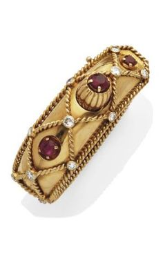 CARTIER  RUBY AND DIAMOND BRACELET, BY CARTIER Rush form, decorated with twisted gold mesh diamond dotted half size and three oval rubies, yellow gold frame, 15 cm, grossweight:.. 70.9 gr, 1960 Signed Cartier Paris, no. 06390