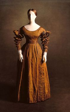 Mourning dress (once black, now faded) worn by Queen Victoria to her first Privy Council on June 20, 1837, the day of her accession to the throne. Scanned from In Royal Fashion by Kay Staniland