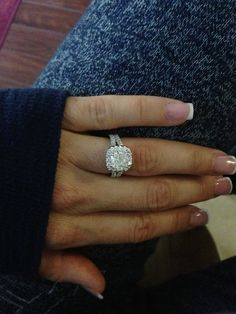 I can't stop staring!! I love my engagement ring!!