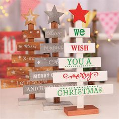 Mini Christmas Tree Ornament - Add a special holiday touch to any living space with this festive wooden sign. Place this ornament on your countertop to greet guests or use it as a fun centerpiece for your holiday get-togethers. Wooden Xmas Trees, Wooden Christmas Crafts, Wooden Christmas Tree Decorations, Christmas Tree On Table, Pallet Christmas Tree, Small Christmas Trees, Christmas Projects, Christmas Tree Ornaments, Merry Christmas