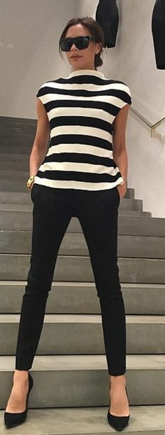 //Who made Victoria Beckham's black pants, sunglasses, and white stripe shirt?