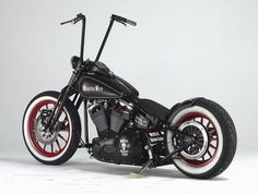 H-D with red mags and whitewalls.