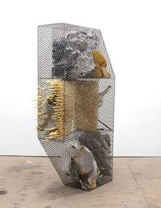 Nick van Woert, Not Yet Titled. 2011, steel, plaster bust, aluminum tape, rain coat, fiberglass torso, polyurethane,  polyurethane adhesive, concrete, bleached poster, monkey wrench, brass, string, 70 x 14.5 x 44 in
