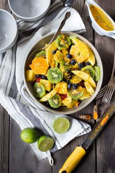 Exotic Turmeric Fruit Salad with fresh grated turmeric root, orange and lime zest and any of your favorite fruits, topped w/ toasted coconut flakes. Sugar free. | www.feastingathome.com #turmeric #freshturmeric #turmericrecipes