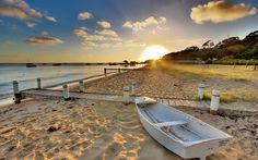 Boat on a sandy beach wallpaper