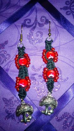 Check out this item in my Etsy shop https://www.etsy.com/listing/479787073/red-glass-beads-on-black-hemp-with