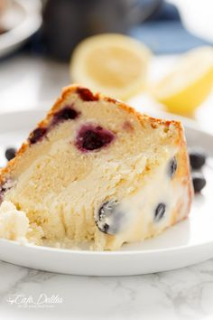 Blueberry Lemon Cheesecake Cake   http://cafedelites.com