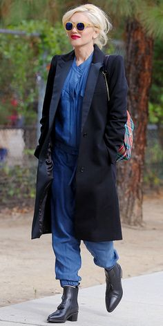 Gwen Stefani dresses up a denim jumpsuit with a sleek satin-trimmed tuxedo blazer and colorful sunglasses
