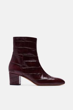 Sculpted by sleek seaming, these block-heeled ankle boots from the fall 2016…