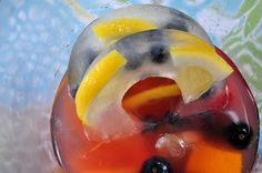 donut pan ice rings with lemonade, blueberries and lemon wedges, with summer sangria!