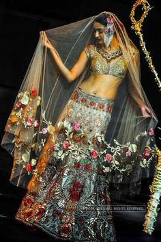 A model showcases a creation by designer Suneet Verma