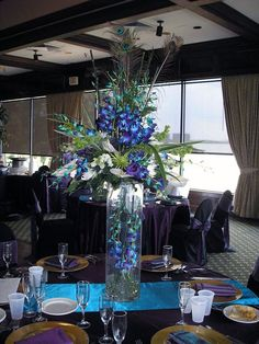 Peacock theme, anyone?......looking for ideas/suggestions! :  wedding decor feather peacock purple teal Awesome Centerpiece