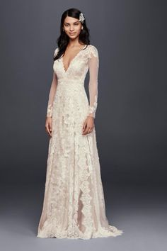Ultra romantic all over lace long sleeve wedding dress with a deep v neckline.