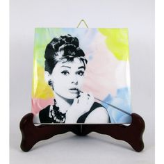 Audrey Hepburn breakfast at Tiffany's collectible ceramic tile... ($9.99) ❤ liked on Polyvore featuring home, home decor and wall art