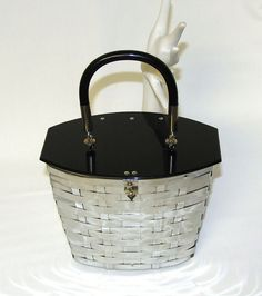 Great 1950's basket purse! I had one just like it!!! It was 'gold' metal and the top was brown marble looking plastic!!