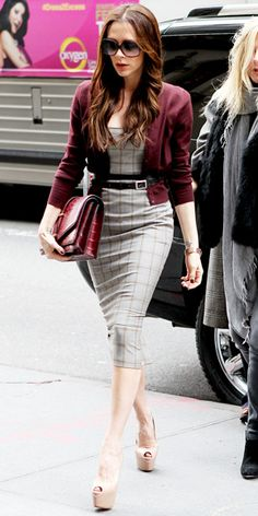 Victoria Beckham  WHAT SHE WORE  After presenting her fall collection on Sunday, Beckham shopped N.Y.C. in a plaid Roland Mouret sheath that she layered with a belted plum cardigan, structured bag and sky-high Louboutins.