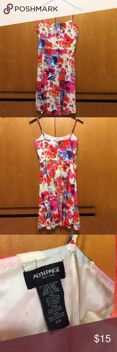 Alyn Paige Watercolor Dress Good quality Floral Watercolor dress. Spaghetti strap. Lined.  97% cotton and 3% spandex. Zipper works but it gets stuck at one point and you just have to pull harder to zip it up. It works just a pain. That's why it's priced low. Alyn Paige Dresses