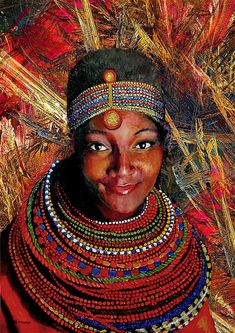 ARTIST:  Michael Durst  Heart of Africa  Mixed Media  This is a mixed media painting, using a Fractal Vision as the background with a portrait of a beautiful African woman in the foreground. This painting shows the kind, loving heart of Africa which anyone who visits here can never forget. The colourful beads of her head piece and necklace sparkle and create wonderful movement around her beautiful face.