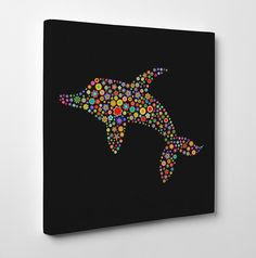 Dolphin from flowers Canvas Artwork. Childrens canvas art is a great way to brighten up the walls of a nursery or kids bedroom. This is a cheap canvas artwork showing a dolphin on canvas made up from little flowers and would make an ideal gift for a child.