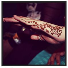 Side of hand, henna design