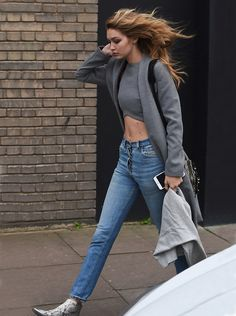 Gigi Hadid cuts a stylish figure in London: #gigihadid #zadidvoltaire #lavishalice #london #zaynmalik #coat #boots #top #supermodel #model