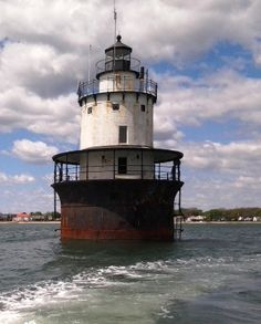 Built in 1898, Butler Flats Light is located offshore in New Bedford Channel at the mouth of the Acushnet River, New Bedford, Massachusetts. The light was built in the sparkplug style and has four stories: a basement for storage; office space; living quarters which are 18 feet in diameter and a watch room.