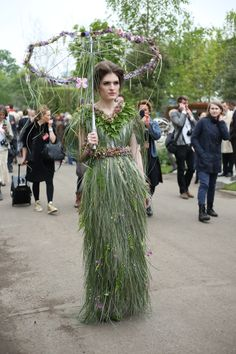 A model shows off a dress made from flowers and plants inspired by Roger Platts's Centenary Garden