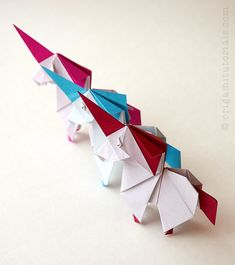 Discover one of the most adorable origami unicorn models out there. This design is by the new origami designer Yudai Imai. The video tutorial is made by the designer himself. Origami Love Heart, Cute Origami, Origami Star Box, Origami Fish, Origami Butterfly, Origami Hedgehog, Origami Mouse, Origami Paper Folding, Origami Elephant