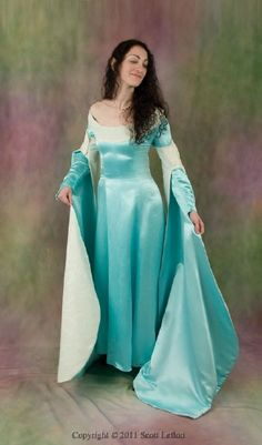 $ 1221   A dress for an eco-friendly medieval lady! 'Bronwyn', our Renfair-styled organic wedding gown, has a favorite princess bride in mind. She has princess seams and features floor-length sleeve extensions and a lovely scoop neckline.