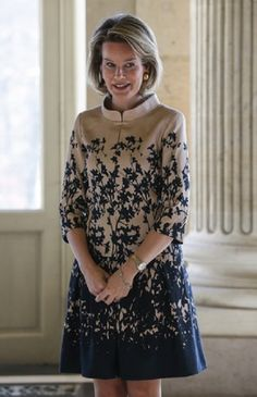Queen Mathilde of Belgium in a pretty cream/navy blue printed pattern dress during a reception for the suppliers holding a 'Royal warrant of appointment' at the royal castle in Laeken - Laken, Brussels, 11.12.13.